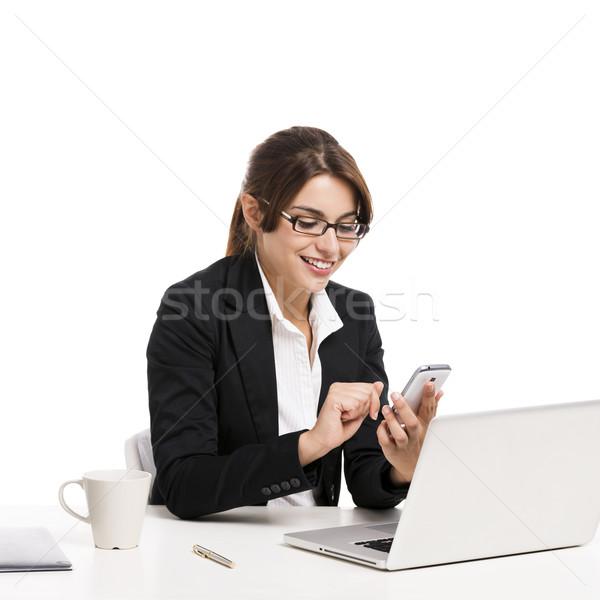 Businesswoman answering phone Stock photo © iko