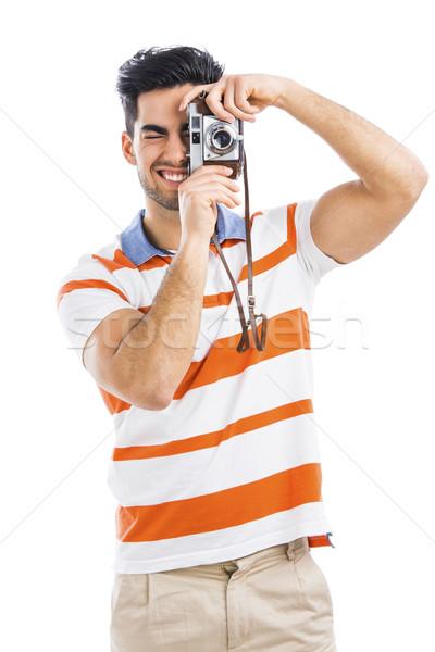 Fényképezés jóképű fiatalember régi fényképezőgép izolált szürke Stock fotó © iko