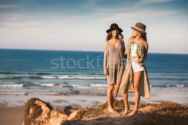Beautiful girls near the coastline Stock photo © iko