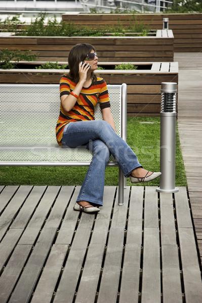 Kozmopolita lány fiatal nő beszél telefon üzlet Stock fotó © iko