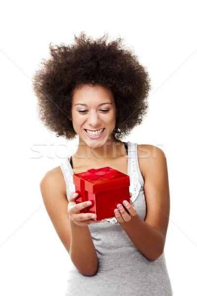 Tart ajándék gyönyörű boldog fiatal nő piros Stock fotó © iko