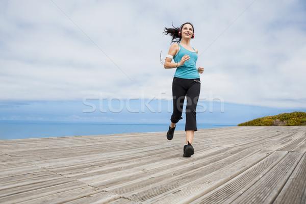 ジョギング 美しい 若い女性 聞く 音楽 女性 ストックフォト © iko