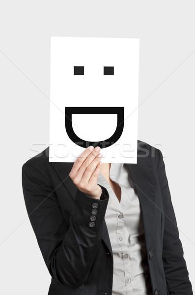 Blij gezicht vrouw tonen blanco papier vel hoofd Stockfoto © iko
