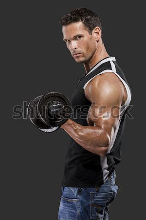 Muscular homem pesos retrato escuro Foto stock © iko