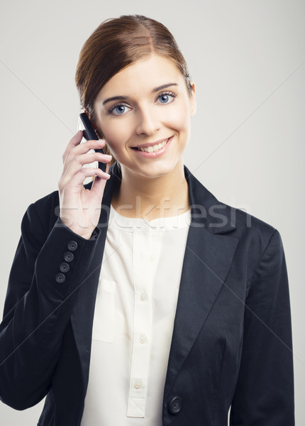 Zakenvrouw telefoongesprek mooie glimlach telefoon Stockfoto © iko