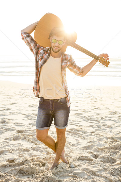 Handsome young man at the beach Stock photo © iko