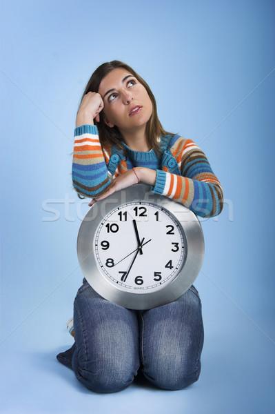 Klok vrouw denken mooie vrouwen Stockfoto © iko
