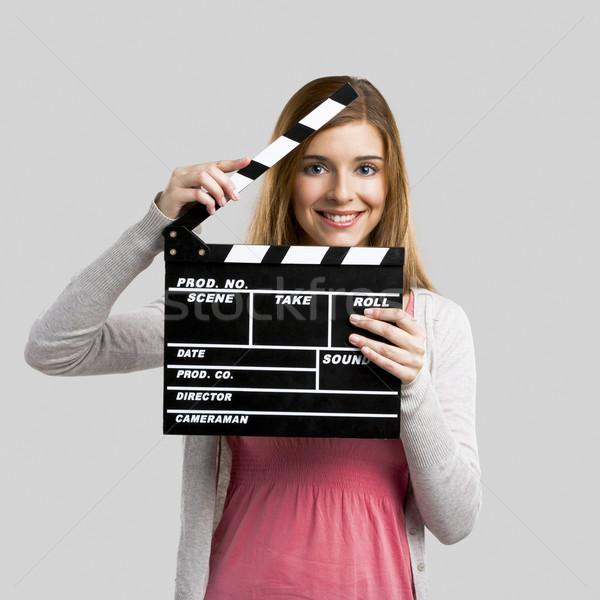 Beautiful girl holding clapboard Stock photo © iko
