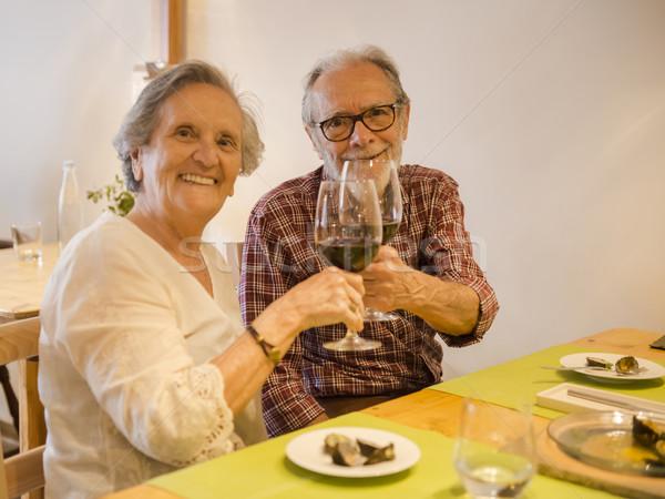 Old couple toasting  Stock photo © iko