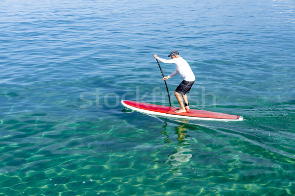 Stock photo: Senior man practicing paddle