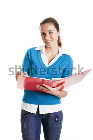Mooie vrouwelijke student schrijven iets geïsoleerd Stockfoto © iko