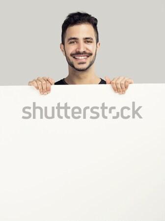 Man billboard mooie glimlachend gelukkig Stockfoto © iko