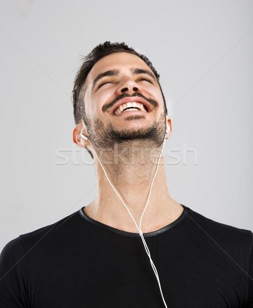 Happy man listen music Stock photo © iko
