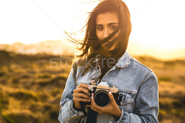 Stock photo: Woman Taking Picture Outdoors