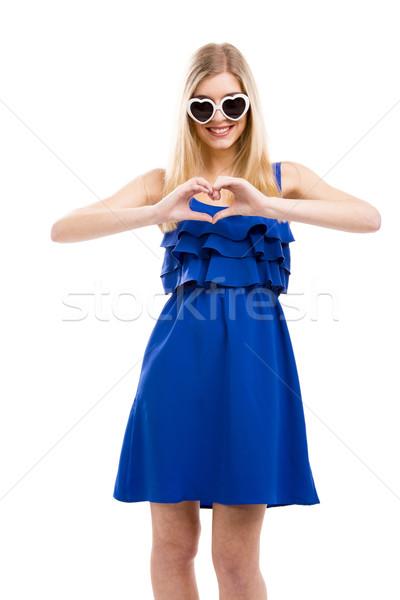 Beautiful woman making a hearth Stock photo © iko