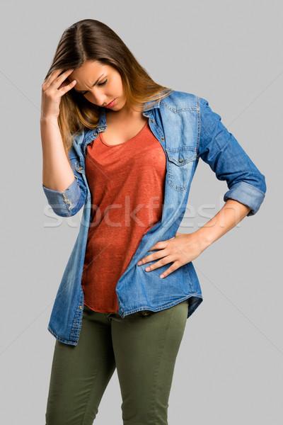 Aggódó nő gyönyörű nő kezek fej valami Stock fotó © iko