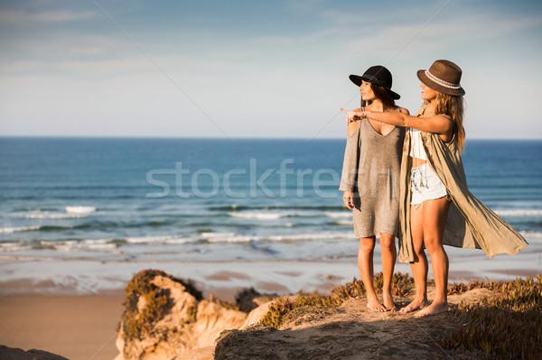 Beautiful girls looking the beach Stock photo © iko