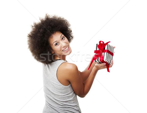Tart ajándék gyönyörű fiatal nő izolált fehér Stock fotó © iko