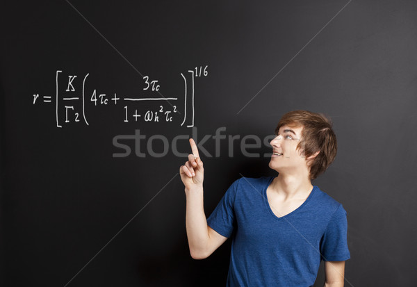 Young man pointing to a equation Stock photo © iko