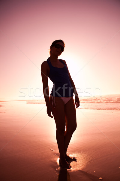 Woman silhouette on the beach Stock photo © iko