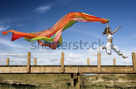 Rainbow woman jumping over the dunes Stock photo © iko
