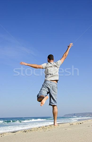 Yaz zaman adam atlama plaj Stok fotoğraf © iko
