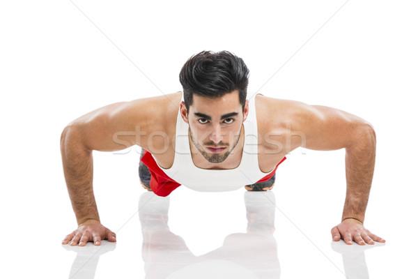 Athletic man doing push-up Stock photo © iko