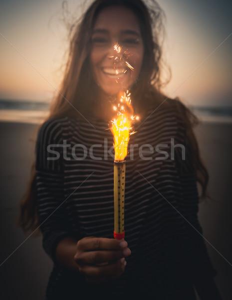 Menina fogos de artifício praia sorrir Foto stock © iko