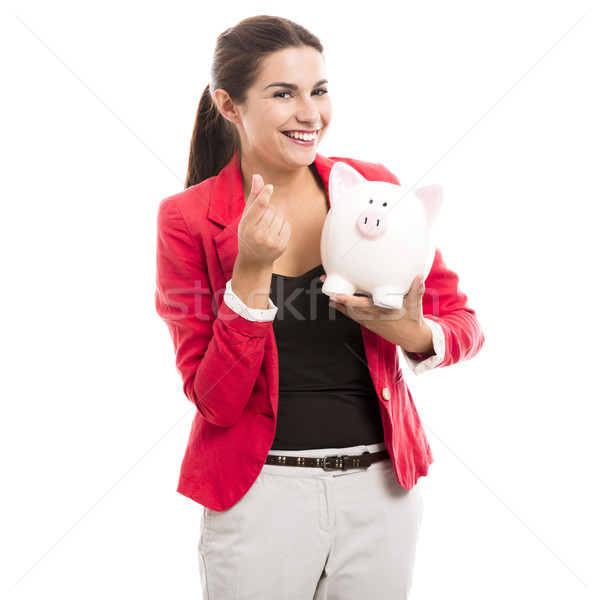 Business woman with a piggy bank Stock photo © iko