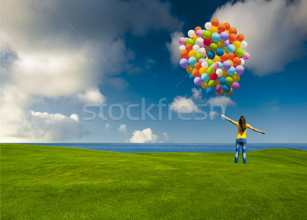Girl with colorful balloons Stock photo © iko