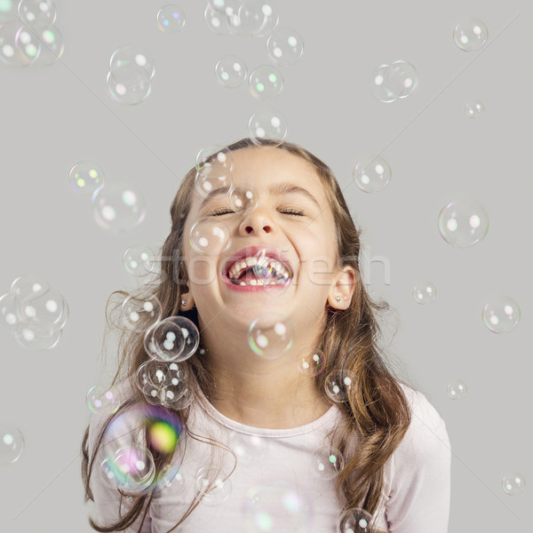 Girl playing with soap bubbles Stock photo © iko