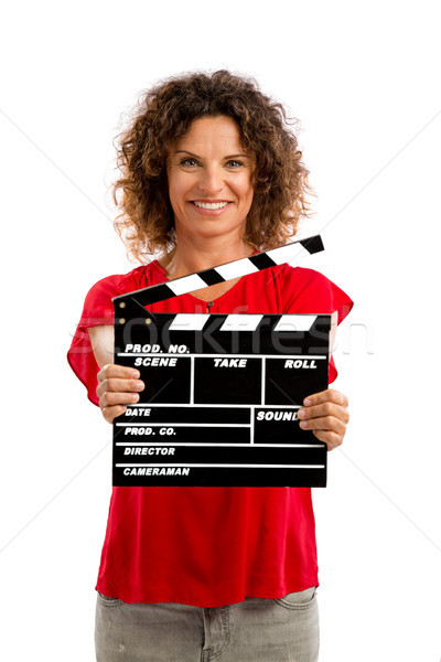 Happy mature woman holding a clapboard Stock photo © iko