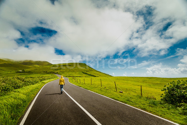 Woman walking over a beautiful road Stock photo © iko
