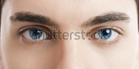 Ojos azules primer plano Foto joven cara belleza Foto stock © iko