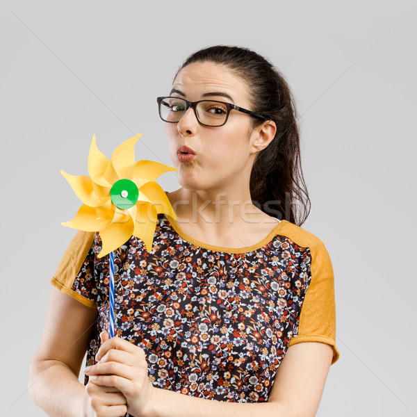 Stock photo: Blowing a windmill