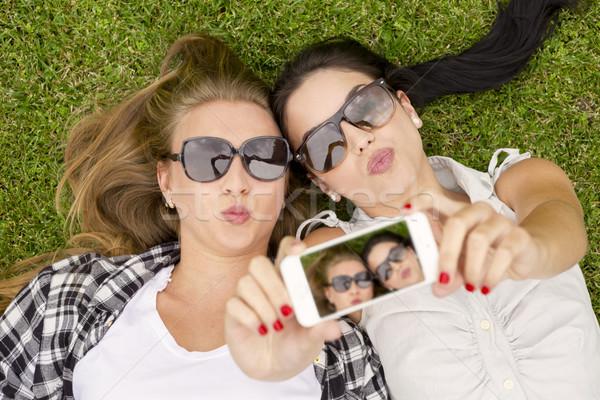 Best friends taking selfies Stock photo © iko
