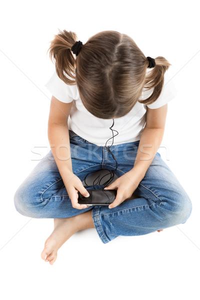 Dinlemek müzik küçük kız oturma zemin mp3 çalar Stok fotoğraf © iko
