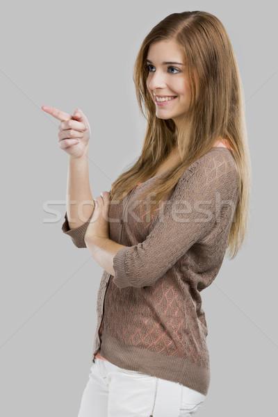 Mutat gyönyörű szőke nő izolált szürke mosoly Stock fotó © iko