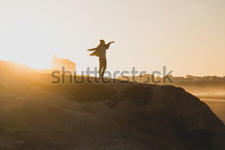 Stock photo: Woman over the cliff