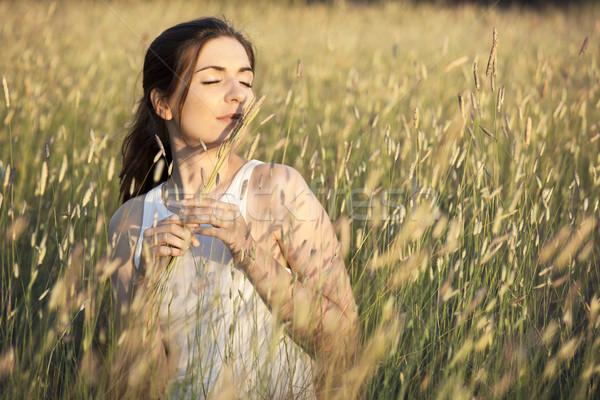 Verão fragrância ao ar livre retrato bela mulher flores Foto stock © iko