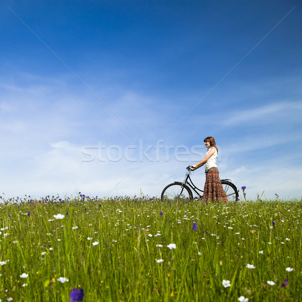 Girl with a bicycle Stock photo © iko