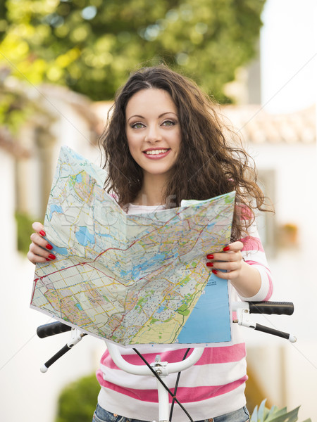 Beautiful tourist searching on the map Stock photo © iko