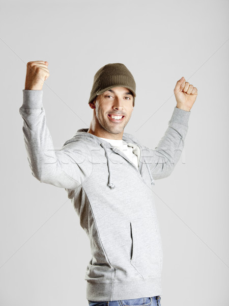 Gelukkig jonge man portret armen lucht man Stockfoto © iko