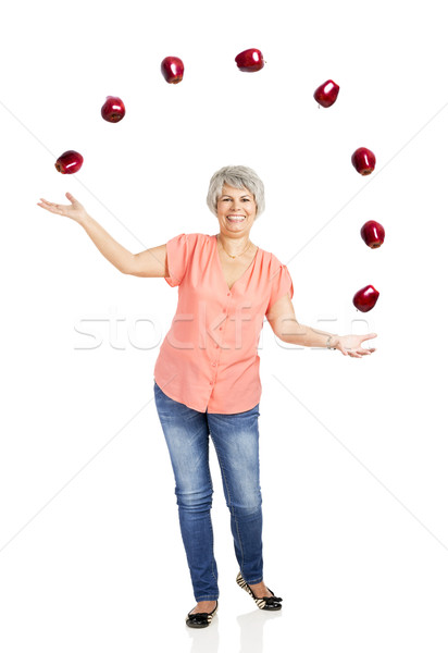 Old woman throwing apples Stock photo © iko