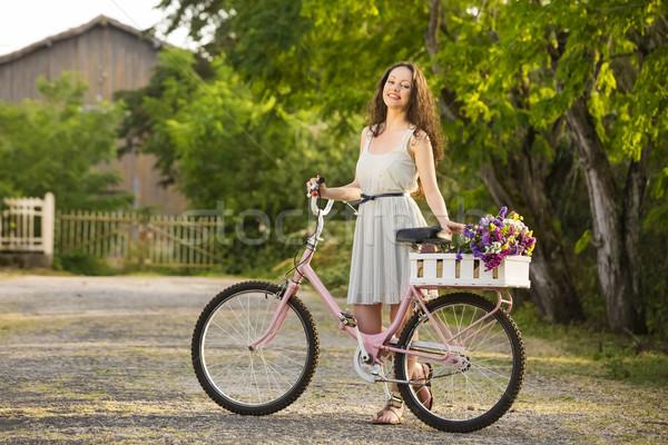 Mutlu kız bisiklet güzel genç kadın tok kır çiçekleri Stok fotoğraf © iko
