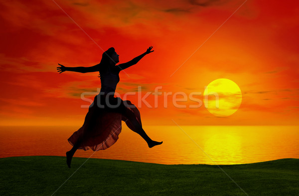 Jumping at the sunset Stock photo © iko