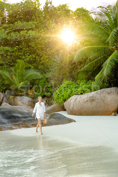 A beautiful woman in the paradise Stock photo © iko