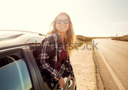 Beautiful girl leaning over the car Stock photo © iko