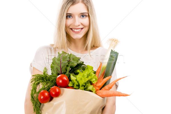 Beautiful woman carrying vegetables stock photo © iko (#3316126) | Stockfresh