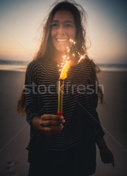 Menina fogos de artifício praia festa Foto stock © iko